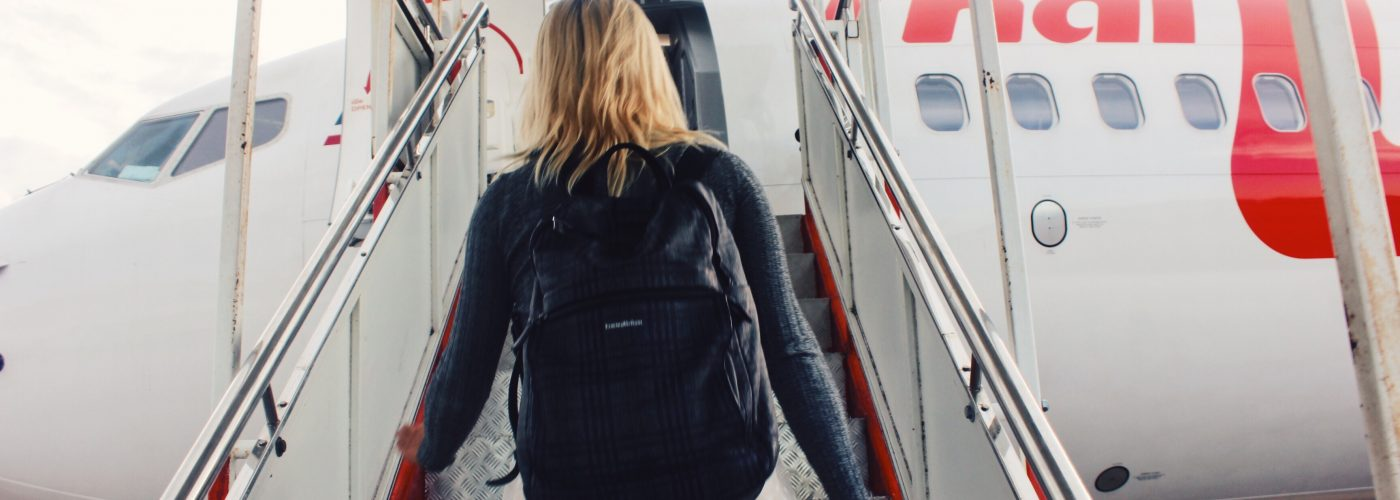 woman-boarding-plane_contributor-use-only-1400x500